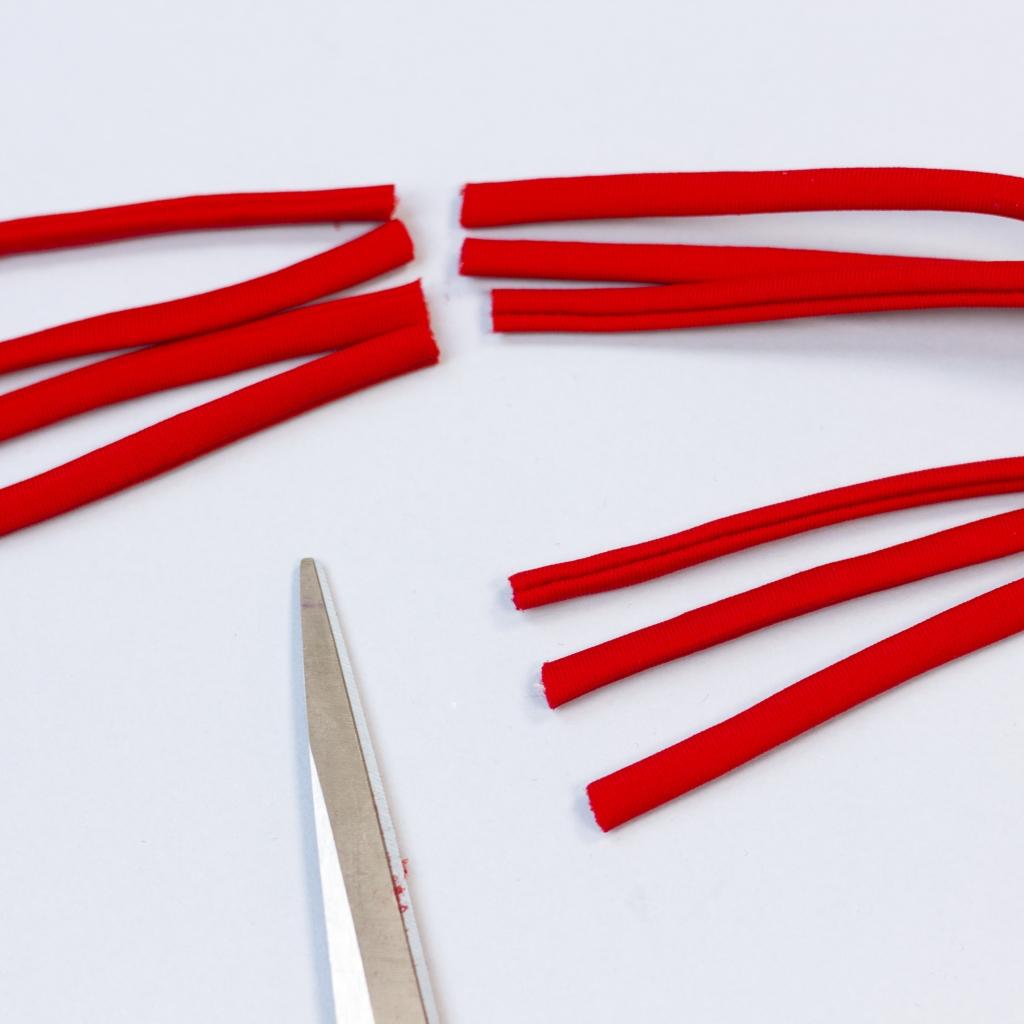 Docięcie sznurków do docelowej długości