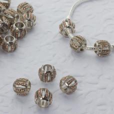 Koralik w srebrnym kolorze z kryształkami beczułka wycięta 6mm