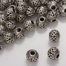 Koralik z ciemnego srebra z wyciętymi zawijasami 11,5mm