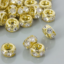 Koralik oponka z kryształkami w okuciu koloru złotego 16x9mm