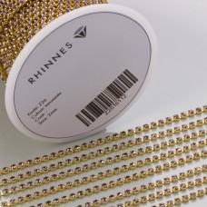 Taśma z kryształkami kolor złoty lt. amethyst 2mm