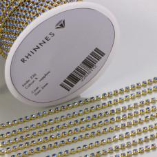 Taśma z kryształkami kolor złoty lt. sapphire 2mm