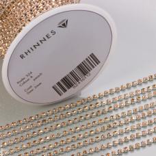 Taśma z kryształkami kolor srebrny lt. peach 2mm