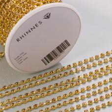 Taśma z kryształkami kolor złoty tl. topaz 3mm