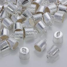 Okrągłe końcówki w kolorze srebrnym z kropeczkami 9mm