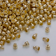 Końcówki do rzemieni i sznurków beczułki w złotym kolorze 4.5 mm
