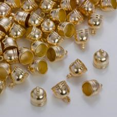 Końcówki do rzemieni i sznurków beczułki w złotym kolorze 8.5mm