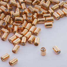 Zapięcie stoper z silikonem do cienkich sznureczków walec złoty 6x4mm