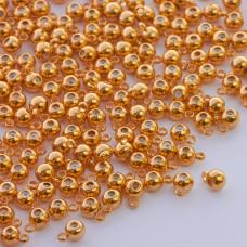 Zapięcie stoper z silikonem do cienkich sznureczków kulka z krawatką złoty 6x4mm
