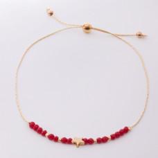 Bransoletka z gwiazdką i czerwonymi kryształkami na łańcuszku