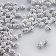 Metalowy koralik owal we wzorki 8mm