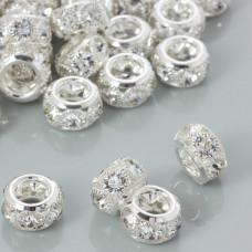 Koralik oponka z kryształkami w okuciu koloru srebrnego 16x9mm