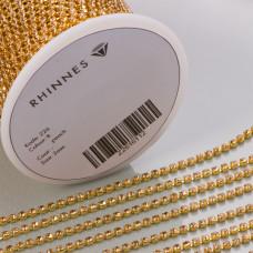 Taśma z kryształkami kolor złoty lt. peach 2mm