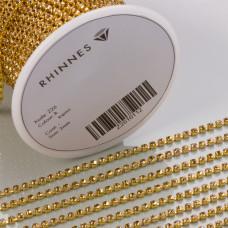 Taśma z kryształkami kolor złoty lt. topaz 2mm