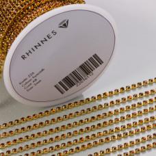 Taśma z kryształkami kolor złoty hyacinth AB 2mm