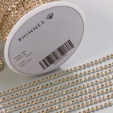 Taśma z kryształkami kolor srebrny lt. topaz 2mm