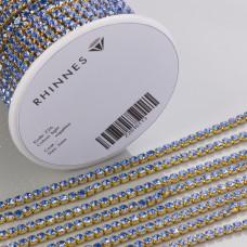 Taśma z kryształkami kolor złoty lt. sapphire 3mm
