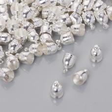 Końcówki do rzemieni i sznurków beczułki w srebrnym kolorze 6.5mm