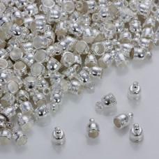 Końcówki do rzemieni i sznurków beczułki w srebrnym kolorze 4mm