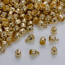Końcówki do rzemieni i sznurków beczułki w złotym kolorze 5,5mm